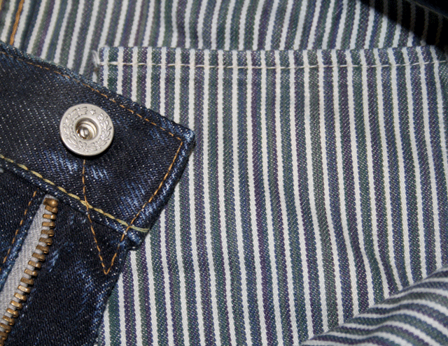 Lined yoke and laurel top button