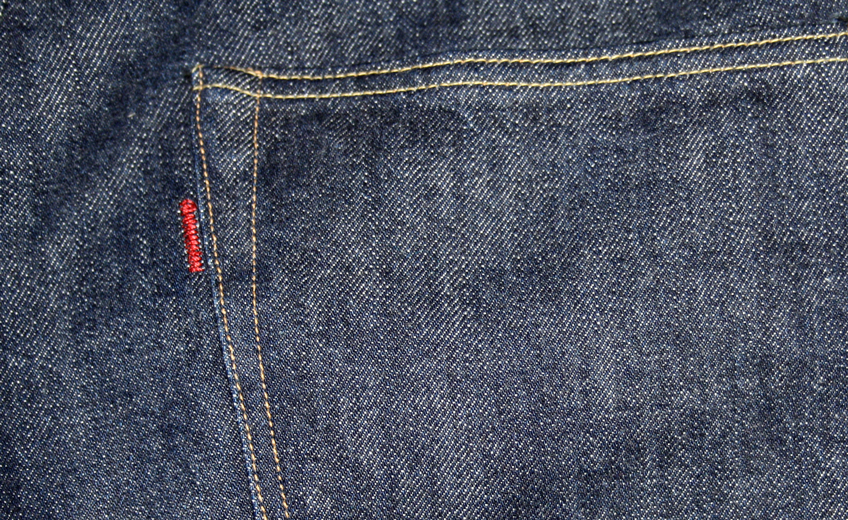 Close-up of 1001 embroidered red tab